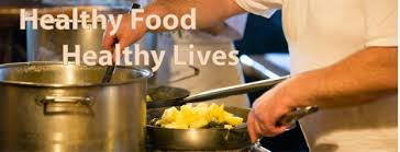 Chef cooking at a stove. Promote proper food handling practices.