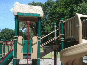 Park playscape with slides and climbing equipment